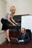 Sexy Lady manipulates a Boss — Stock Photo