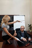 Sexy Secretary manipulates a Boss. — Stock Photo