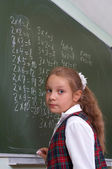Lesson. Schoolgirl at the blackboard. — Stock Photo