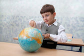 Elementary school. Schoolboy with globe — Стоковое фото