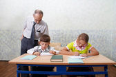 Teacher and children — Foto Stock