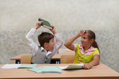 Elementary school. Fight on lesson. — Stock Photo