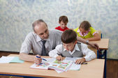 Elementary school. Teacher and children — Stock fotografie