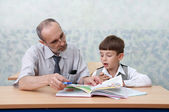 Elementary school. Teacher and schoolboy — Foto de Stock