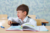 Elementary school. Lesson. Lazy boy. — Stock Photo