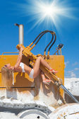 Hot and sexy on snowy dozer — Stock Photo