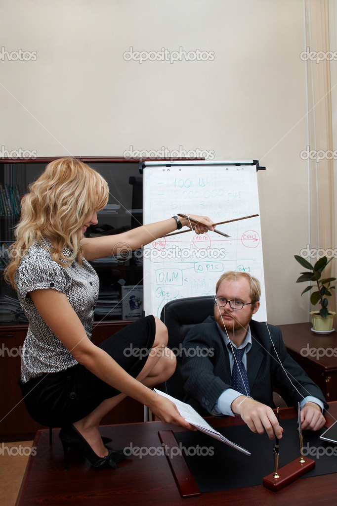 Sexy Secretary manipulates a Boss. Boss sign a treaty. Office scene.  Stock Photo #1401360