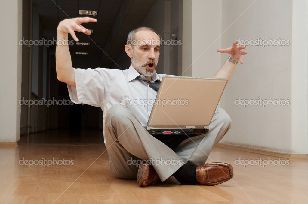 Director sitting on the floor, incredible feelings!  Stock Photo #1401442