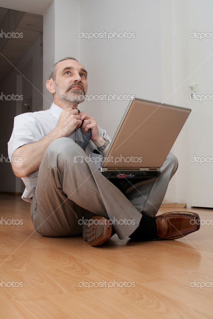 Man sitting on the floor and thinking. Feel tiredness. — Stock Photo #1401463