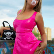 Babe in pink latex - Stock Photo