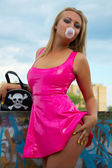 Babe in pink latex — Stock Photo