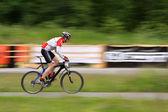 Mountain Biker in race — Stock Photo