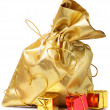 Golden bag with gifts — Stock Photo #1379634