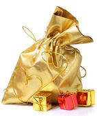 Golden bag with gifts — Stock Photo