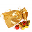 Golden bag with gift boxes — Stock Photo