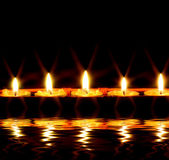 Candles by the water — Stock Photo