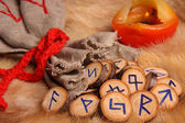Runes with pouch and candle close-up — Stock Photo