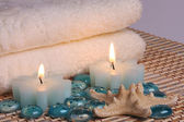 Towels and candles — Stock Photo