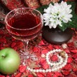 Still life with wine, apple and flowers — Stockfoto