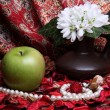 Still life with apple and flowers — Stock Photo