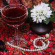Still life with wine, flowers and pearls - Stock Photo
