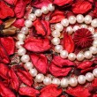 Royalty-Free Stock Photo: Pearl necklace with red petals