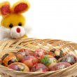 Stock Photo: Easter rabbit with basket of easter eggs