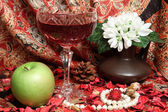 Still life with wine, apple and flowers — Stock Photo