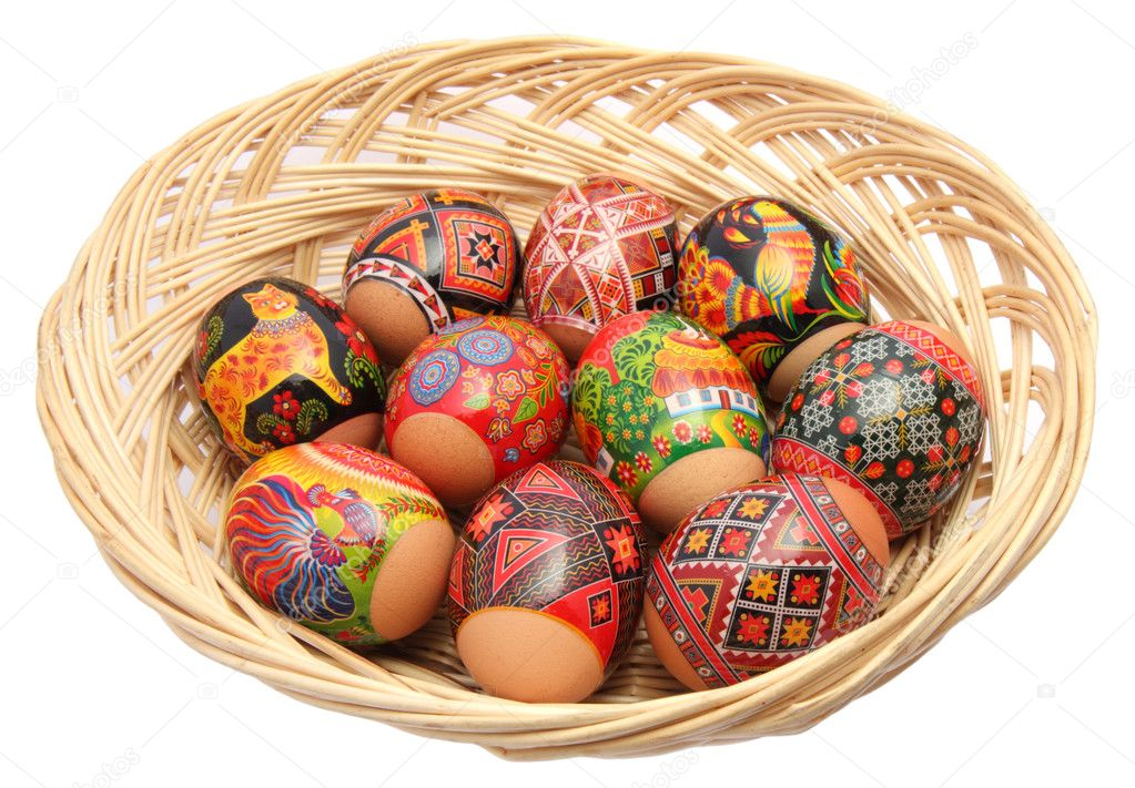 Basket with multicolored easter eggs on the white background — Stock Photo #1436281