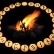 Runes around fire on black background - Stock Photo