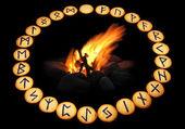 Runes around fire on black background — Stock Photo