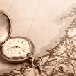 Old silver watch on old map — Stockfoto