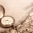 Old silver watch on old map — Stok fotoğraf