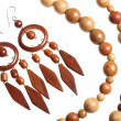 Wooden beads and earrings — Stock Photo
