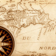Compass on old map — Stockfoto