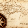 Compass on old map - Stock Photo