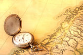 Ancient map with old silver watch — Stock Photo