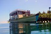 Boat in tropical sea — Stock Photo