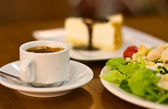 Cup of espresso with cake and salad — Stock Photo
