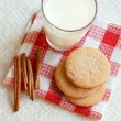 Cinnamon cookies with glass of milk - Stock Photo