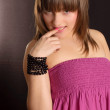 A naive young girl in a pink dress — Stock Photo #1628653