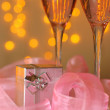 Two glasses of champagne and a gift — Stock Photo #1694035