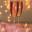 Two glasses of champagne with decor — Stock Photo