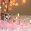 Two glasses of champagne and a gift — Stock Photo #1694509