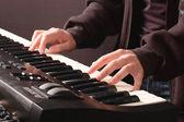 Beautiful man's hands on the keys — Fotografia Stock