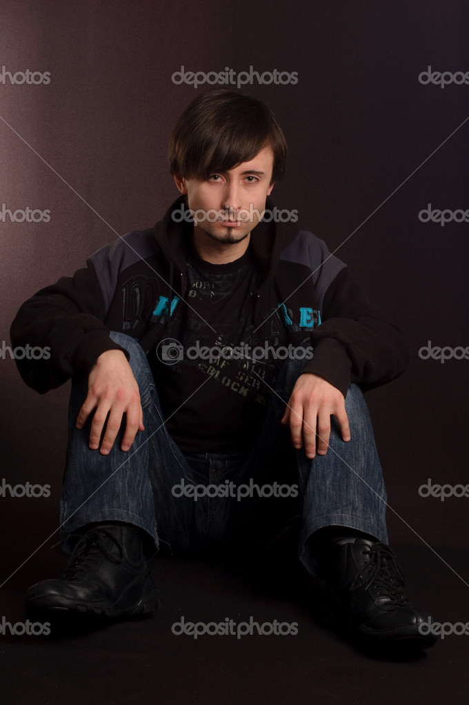 A young man sitting on the floor — Stock Photo #1728698