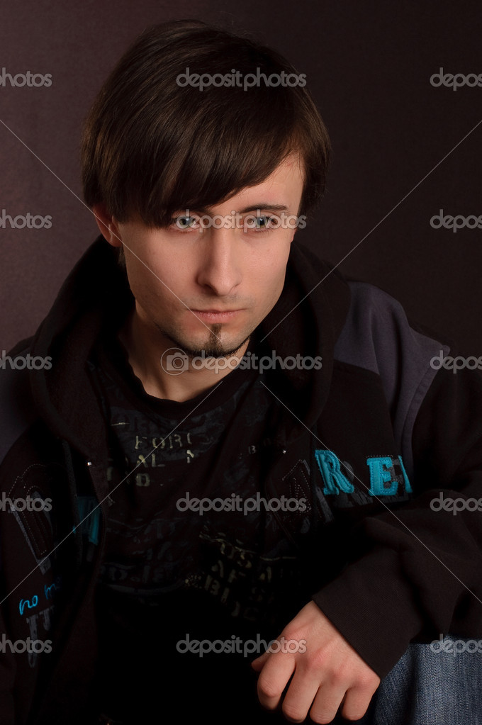 A young man sitting on the floor  Stock Photo #1728814