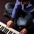 A young man playing on a synthesizer — Stock Photo #1735212