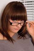 Portrait of a young brunette in glasses — Stock Photo