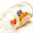 A glass jar with colored candies — Stock Photo